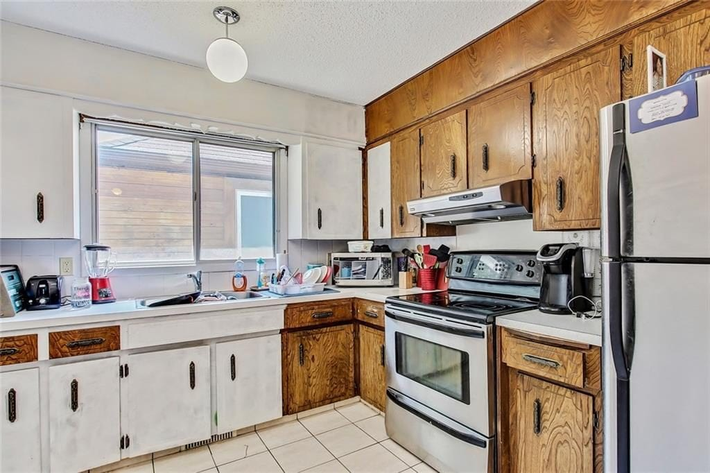 kitchen view of investment property for sale in capitol hill nw calgary