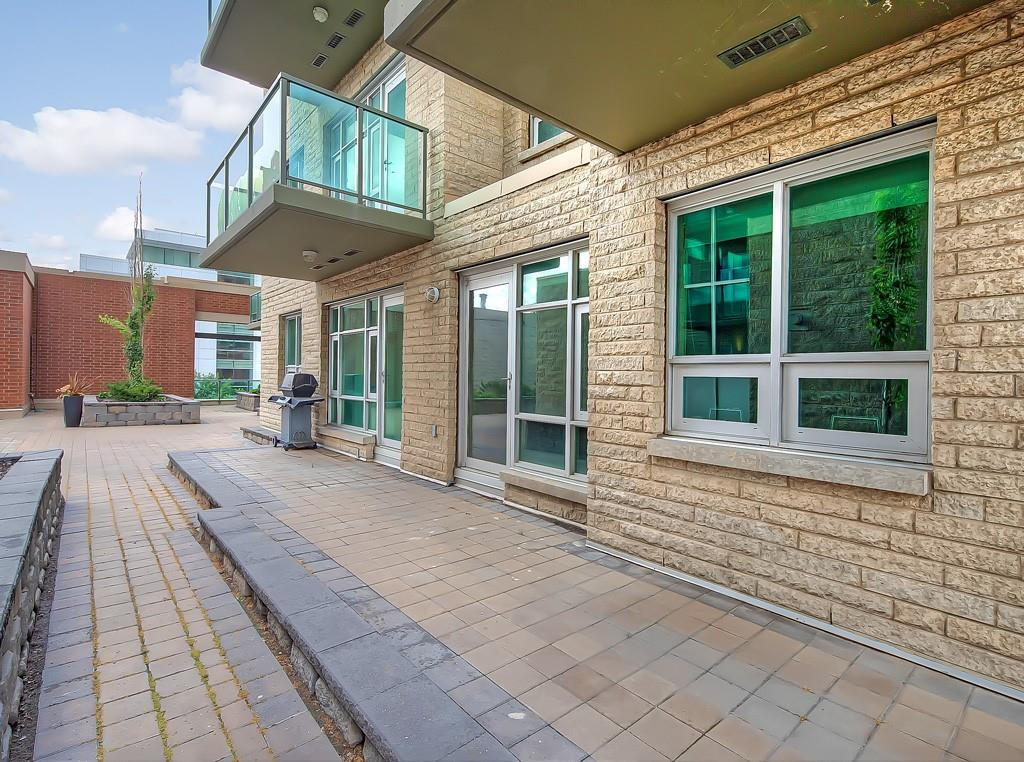 patio access from sasso condo, 208 1410 1st street se