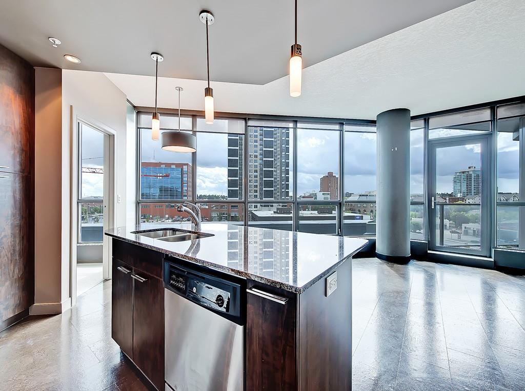 keynote one condo for sale kitchen living room 409 220 12th avenue SE