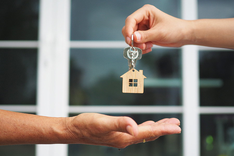 home buyer taking keys to a house